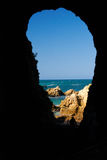 Sea Through Cave Wall. The Indian Ocean seen through an opening in the cliffs along the Knysna Heads, South Africa, August 2007 Stock Photography