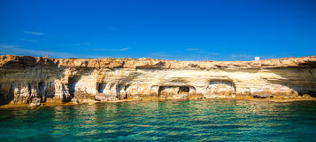 Sea caves at Cape Greco Stock Images