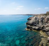 Sea caves of Cavo greco cape. Mediterranean sea landscape. Skyline Royalty Free Stock Images