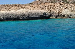 Sea caves in Cyprus Mediterranean sea. Blue and clear water, view from the yacht Royalty Free Stock Photos