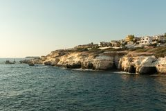 Sea caves formed by water at the coast of Cyprys. Near Peyia, Paphos Royalty Free Stock Photos