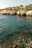 Sea caves formed by water at the coast of Cyprys. Near Peyia, Paphos Royalty Free Stock Images