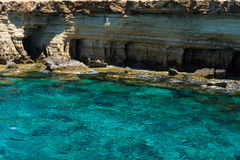 Sea caves near Ayia Napa, Mediterranean sea coast, Cyprus. Sea caves littoral caves near Ayia Napa, Mediterranean sea coast, Cyprus. They are formed primarily by Royalty Free Stock Photo