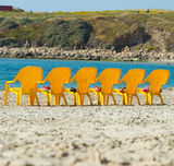 Sea and chairs Stock Image