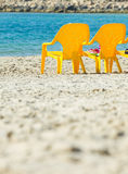 Sea and chairs Stock Photos