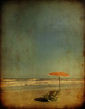 Sea chairs with umbrella ,grunge effect Royalty Free Stock Images