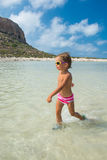 At the sea. A child walks along the sea shore in sunglasses Stock Images