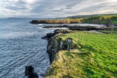 Cliff on the Antrim Coast. This is a sea cliff on the Antrim Coast in Northern Ireland stock photography