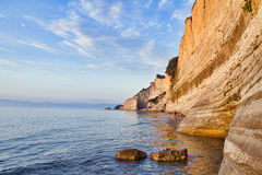 Sea with a cliff background. A sea with a cliff and sky background Royalty Free Stock Photography