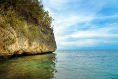 Sea cliff on Bolilanga Island. Togean Islands Stock Photography
