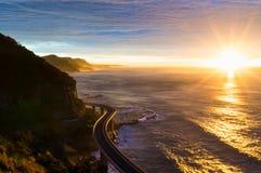Sea cliff bridge along Australian Pacific ocean coast on sunrise Royalty Free Stock Images