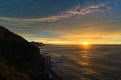 Sea cliff bridge along Australian Pacific ocean coast on sunrise Stock Image