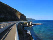 Sea Cliff Bridge at Australian coastline. A picturesque coastal road: the Grand Pacific Drive (NSW, Australia) with a footpath on the Sea Cliff Bridge Royalty Free Stock Images