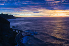 Sea Cliff Bridge on sunrise in pink and yellow hues Stock Photography