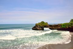 Sea cliff and small temple in Pura tanah lot park in Bali Stock Images