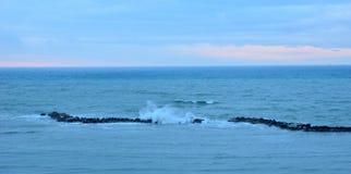 Sea with cliff Stock Photos