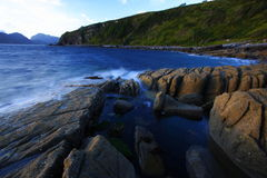 Sea and cliff at twilight, Scotland Royalty Free Stock Images