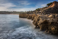 Sea cliffs in Albufeira and the beautiful beach in Portugal. stock photo