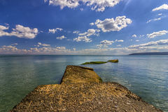 sea cliffs and clear water Stock Images