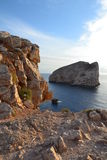 Sea cliffs and island, Sardinia Stock Images