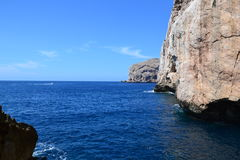 Sea cliffs and island, Sardinia Royalty Free Stock Photography