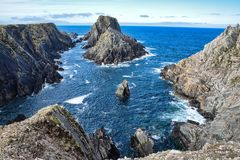 Sea cliffs at Malin Head. This is a rock island surrounded by sea cliffs.  This photoghaph was taken in Malin Head Ireland Stock Image