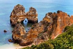 Sea cliffs on Praia do Camilo beach, Algarve, Portugal Stock Photo