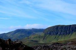 Sea Cliffs Touching the Clouds. Lush sea cliffs touching the clouds in Scotland Stock Photo