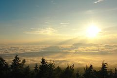 Sea of clouds. View from the Fujiyama in Japan, above the clouds level at sunset Royalty Free Stock Photo
