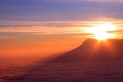 Sea of clouds. Mountain ridge with high cloudness at sunset time. Babugan, Crimea, Ukraine stock image