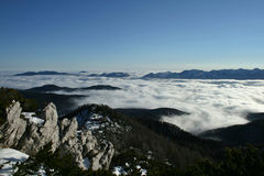 Sea of Clouds. A view from the mountain to the winter landscape and the sea of clouds below Stock Images