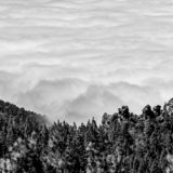 Sea of clouds announcing a storm reaching the island royalty free stock photography