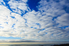 A sea of clouds cover the blue sky Stock Photography