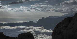 A sea of clouds decorates mountains royalty free stock image