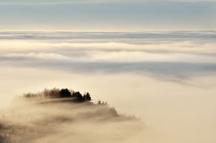 Sea of clouds. Landscape over the clouds in Buila-Vanturarita National Park, Romania Stock Images