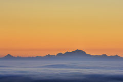 Sea of clouds and Mont Blanc peak during sunrise Stock Photos