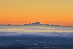 Sea of clouds and Mont Blanc peak during sunrise, Beaujolais lan Stock Image