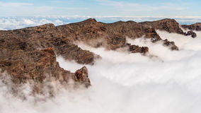 Sea of clouds. Moutains passing through the clouds in La Palma, Canary Island Royalty Free Stock Images