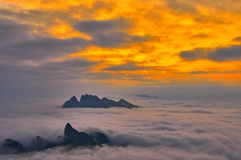 Sea of clouds in sunset. A grand view of sea clouds at the top of mountains in sunset , SanQin mountain in JiangXi , China royalty free stock images