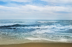 Sea. Cloudy weather and stubborn sea in Spain Royalty Free Stock Photo