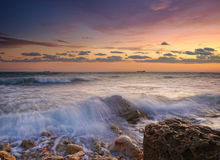 Sea coast. In the summer, a sunset over the sea Royalty Free Stock Images