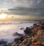 Sea coast. In the summer, a sunset over the sea Royalty Free Stock Photo
