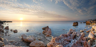 Sea coast. In the summer, a sunset over the sea Royalty Free Stock Photos