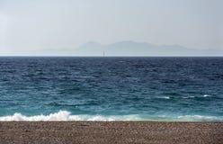 Sea coast ,Aegean sea, Greece, sea on a Sunny day. Islands on the horizon, sail in the sea stock photos