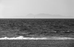 Sea coast ,Aegean sea, Greece, sea on a Sunny day ,Islands on the horizon, sail in the sea. Black and white photo royalty free stock images