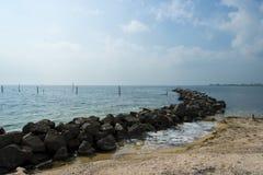 Sea coast against  blue sky background. Stock Photos