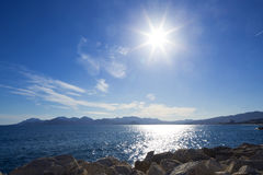 Sea coast with azure water. And sunshine Stock Photography