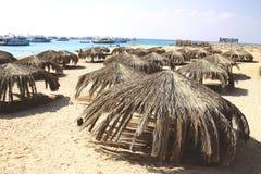 Sea coast with beach umbrellas. And sand royalty free stock photo