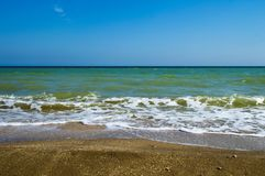 Sea coast and blue sky. Sea coast water blue sky  vacation sand summer beach wave royalty free stock image