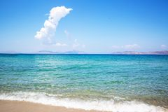Sea coast and blue turquoise water. Blue sunny sky, summertime stock images